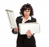 Portrait of mature woman with box, wearing glasses, isolated on white, looking at camera.