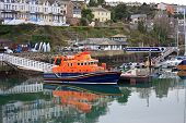 pic of outboard engine  - lifeboat reflected in the waters of Brixham harbour - JPG