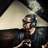 man in music studio smoking weed