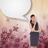 Thoughtful asian businesswoman with speech bubble against digitally generated girly floral design