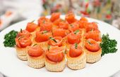 Tartlets with smoked salmon on banquet table
