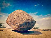 Vintage retro hipster style travel image of Krishna's butterball -  balancing giant natural rock sto