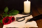 stock photo of masochism  - a letter with whip candle and rose - JPG