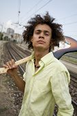 stock photo of stratocaster  - cool guy with his guitar at a train station - JPG