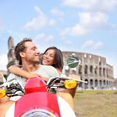 foto of scooter  - Rome couple on scooter by Colosseum - JPG