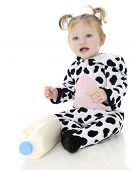stock photo of baby pig  - An adorable baby girl happy in her holstein cow costume - JPG