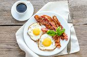 pic of deli  - Fried Eggs With Bacon On The Wooden Table - JPG