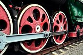 stock photo of train-wheel  - wheel detail of a vintage steam train locomotive - JPG