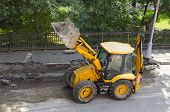 picture of wheel loader  - Wheel loader machine on the road - JPG