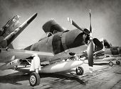 stock photo of fighter plane  - World War II era fighter planes in stained old photo - JPG