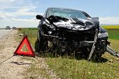 pic of bender  - accident car and warning triangle beside road - JPG