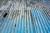 stock photo of asbestos  - Corrugated blue asbestos ceiling panels - JPG
