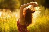 image of beatitudes  - Happy woman with her hair in the evening sun - JPG