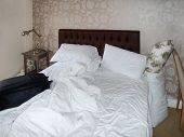 picture of untidiness  - bedroom scenery with bed and untidy bedclothes - JPG