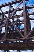 foto of girder  - Rusted steel girders hold up a railroad bridge in Pittsburgh Pennsylvania - JPG