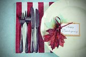 stock photo of pale  - Retro vintage style Happy Thanksgiving dining table place setting in modern pale blue red and white theme with vintage turkey tureen - JPG
