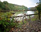 picture of split rail fence  - Bicycle left along a split rail fence - JPG