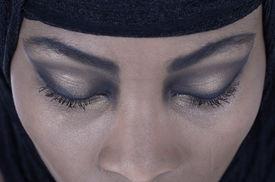 pic of yashmak  - Portrait of young African American woman wearing black shawl - JPG