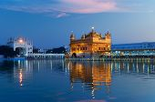 stock photo of harmandir sahib  - Golden Temple Harmandir Sahib also Darbar Sahib in the evening at sunset - JPG
