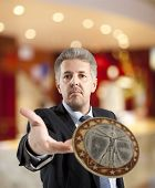 stock photo of throw up  - Close up of businessman throws a coin - JPG