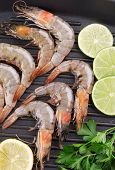 pic of shrimp  - Raw shrimps on pan with lemon - JPG