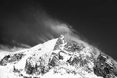 stock photo of windy  - windy mountain lanscape after a recent snow day black and white - JPG
