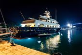 stock photo of yachts  - Beautiful view of luxurious private yacht moored at night port - JPG