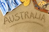 picture of boomerang  - Australia beach background with boomerang towel and flip flops - JPG