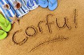 foto of starfish  - The word Corfu written on a sandy beach with beach towel starfish and flip flops - JPG