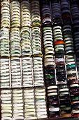 picture of jade  - Color shot of many jade bracelets displayed in a market - JPG
