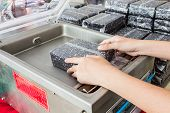 pic of jasmine  - Farmer packing a bag of Rice jasmine berry rice in small plastic bag by machine - JPG