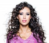 picture of brown-haired  - Face of a beautiful young woman with brown long ringlets hairs and dark fashion make up - JPG