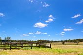 stock photo of haystack  - Australian rural field landscape with haystacks blue sky and white clouds - JPG