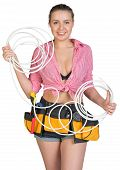 stock photo of coil  - Sexy woman wearing tool belt - JPG