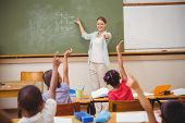 image of pupils  - Pupils raising their hands during class at the elementary school - JPG