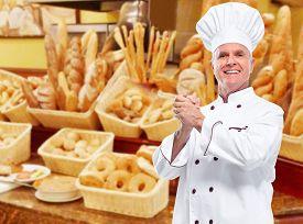 stock photo of bakeshop  - Mature professional chef man in modern restaurant - JPG