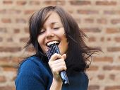 stock photo of singing  - Young tousle - JPG