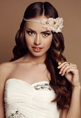pic of headband  - fashion studio portrait of beautiful young girl with dark hair with flower - JPG