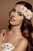 image of headband  - fashion studio portrait of beautiful young girl with dark hair with flower - JPG