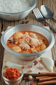 pic of curry chicken  - Chicken Mussaman Curry with ingredient Spices and herbs - JPG