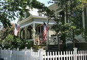 pic of foreground  - American flags raised in front of 2 houses - JPG