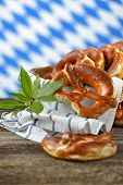 pic of pretzels  - Fresh Bavarian pretzels in a breadbasket on a wooden table - JPG