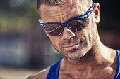 stock photo of hustle  - Portrait of a handsome young man in sunglasses - JPG