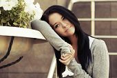 pic of daydreaming  - Happy young fashion woman with a flower daydreaming - JPG
