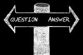 foto of opposites  - Opposite arrows with Question versus Answer. Hand drawing with chalk on blackboard. Choice conceptual image - JPG