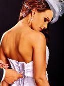 foto of corset  - Beautiful bridal trying on wedding dress - JPG