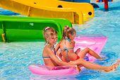 stock photo of inflatable slide  - Kids on water slide at aquapark - JPG