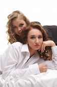 stock photo of bisexual  - Studio portrait of attractive girls posing at camera - JPG
