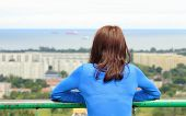 picture of observed  - Woman watching view of the city Gdansk from observation tower woman looks at panorama of city style melancholy concept - JPG
