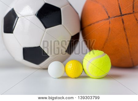 sport, fitness, game, sports equipment and objects concept - close up of different sports balls set